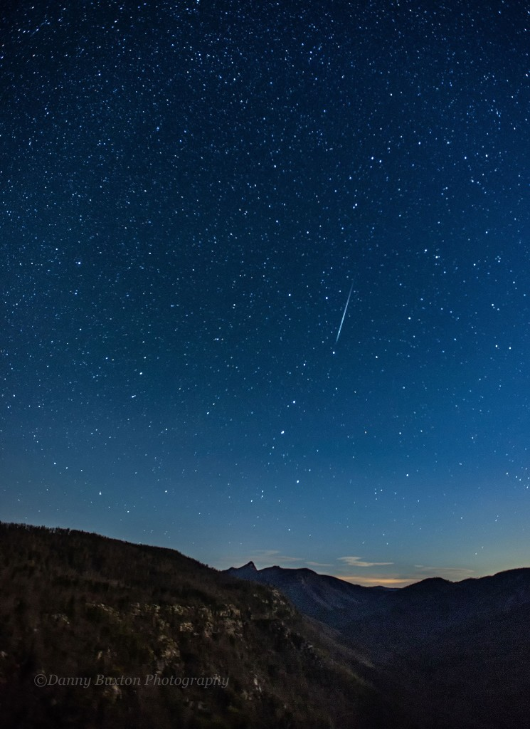 Stars above Linville Gorge.  Meteor streaks down over Table Rock. (Photo: Danny Buxton)