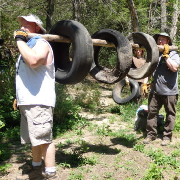 Team Fords River with Dozens of Tires